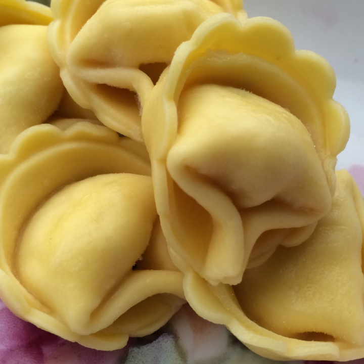 Three Cheese - Egg Tortellini   10 lb. Bulk case (90-94 per lb.)  Imported Romano, Ricotta and Parmesan Cheese blended with Fresh Parsley, Nutmeg and Black Pepper. Wrapped in our Egg Pasta.