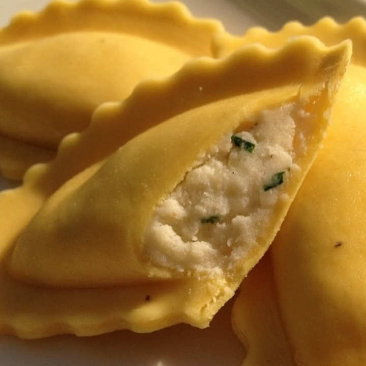 """Three Cheese Mezza Luna - Egg Pasta   Mezza Luna 3.25"""" Half Moon  (20-22 per lb.) - 10 lb. Bulk  Making its Debut with Ricotta Cheese, Imported Romano Cheese, Parmesan Cheese, Fresh Parsley, with a Touch of Nutmeg & Pepper, an Italian Tradition."""