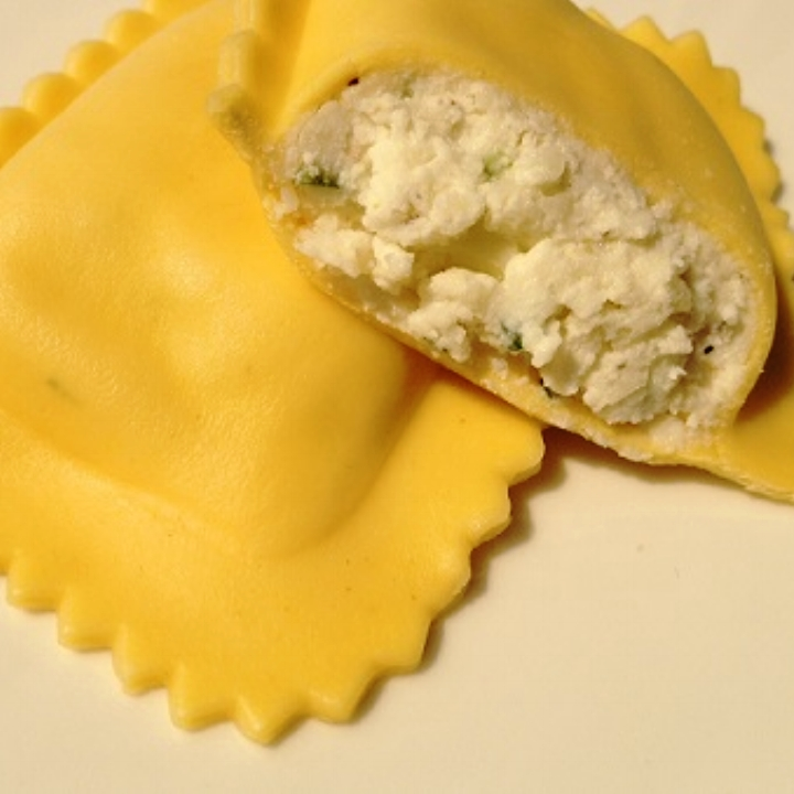 """Goat Cheese - Egg Pasta   Jumbo 3"""" Square (10-12 per lb.) - 10 lb. Bulk  A Tasty Blend of Chevre (Goat Cheese), Ricotta Cheese, Mozzarella Cheese, Parsley & Spices Surrounded by our Egg Pasta. The Addition of more Goat Cheese makes this Ravioli even Better than Before!"""