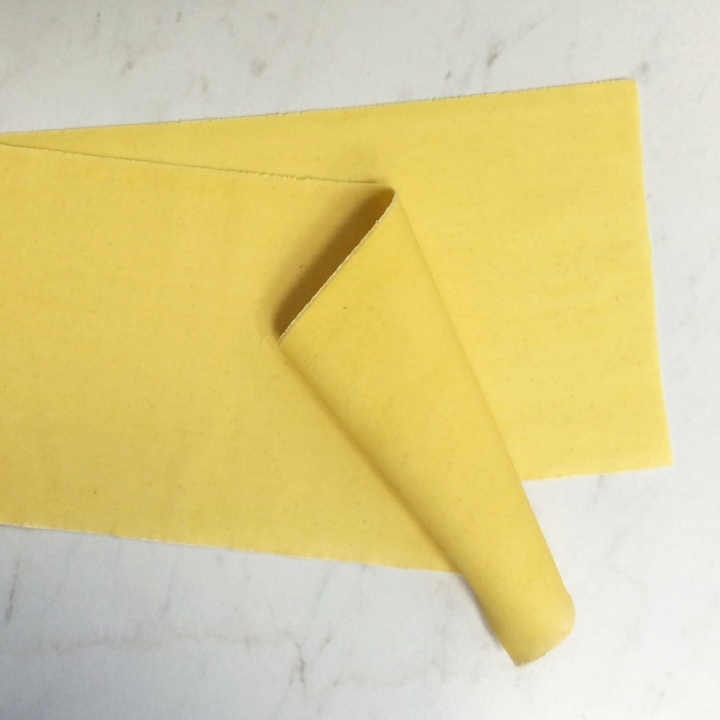 """Egg Sheets for Ravioli (Thinner)   Pack Size 2/5 lb. Vacuum Packed ~54 Sheets, Separated by dry wax sheets. 6""""W x 17""""L x 1mm thick"""