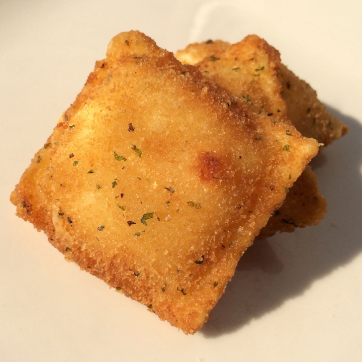"""Breaded Nacho Cheese - Deep Fry   Medium 2"""" Square  (24-26 per lb.) - 10 lb. Bulk  Favorites of Italy & Mexico Combined in this Mildly Spicy Little Number. Ricotta, Monterey Jack, Cheddar Cheese, Jalapeños, Red Peppers & Onion fill this Breaded Ravioli. Ready to Deep Fry and Serve with Your Favorite Sauce or Salsa."""