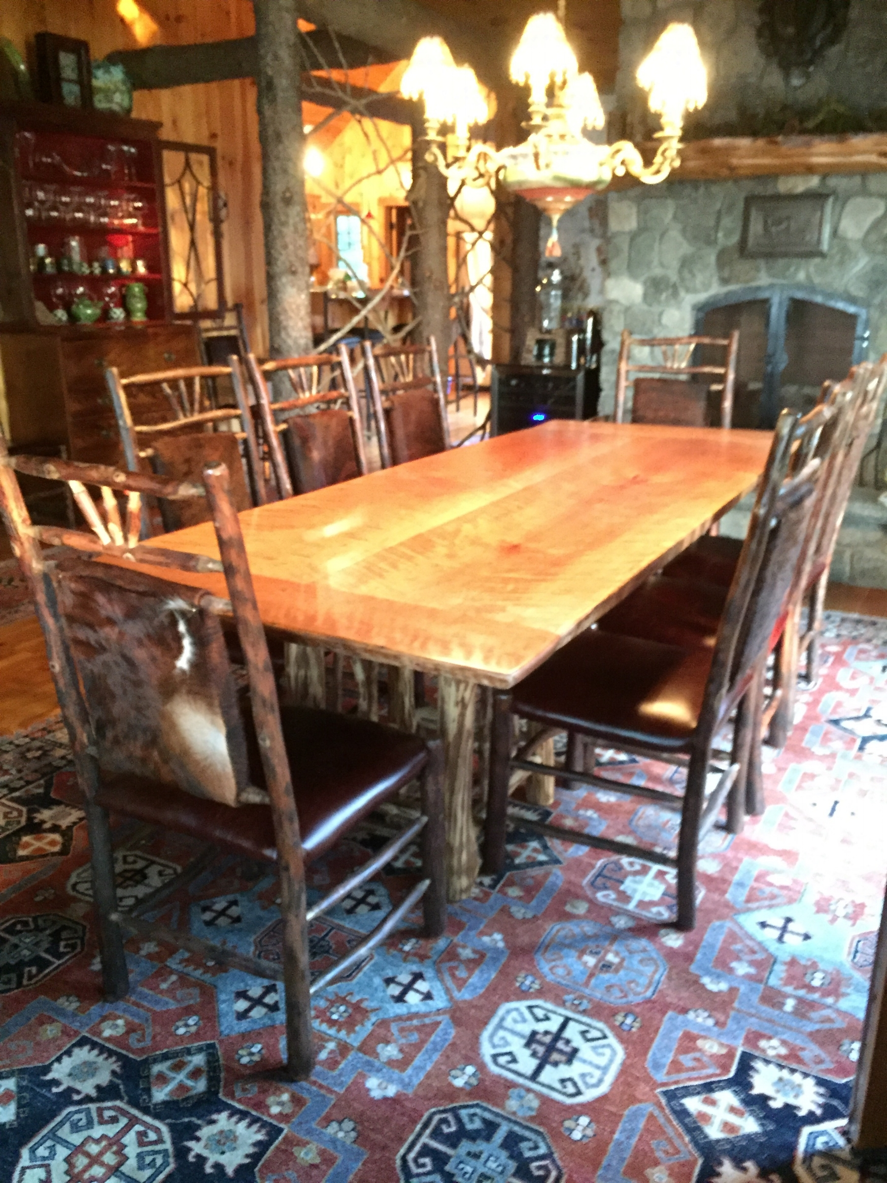 Custom Curly Cherry slab dining table set on an Ironwood base and our 3 finger hickory chairs
