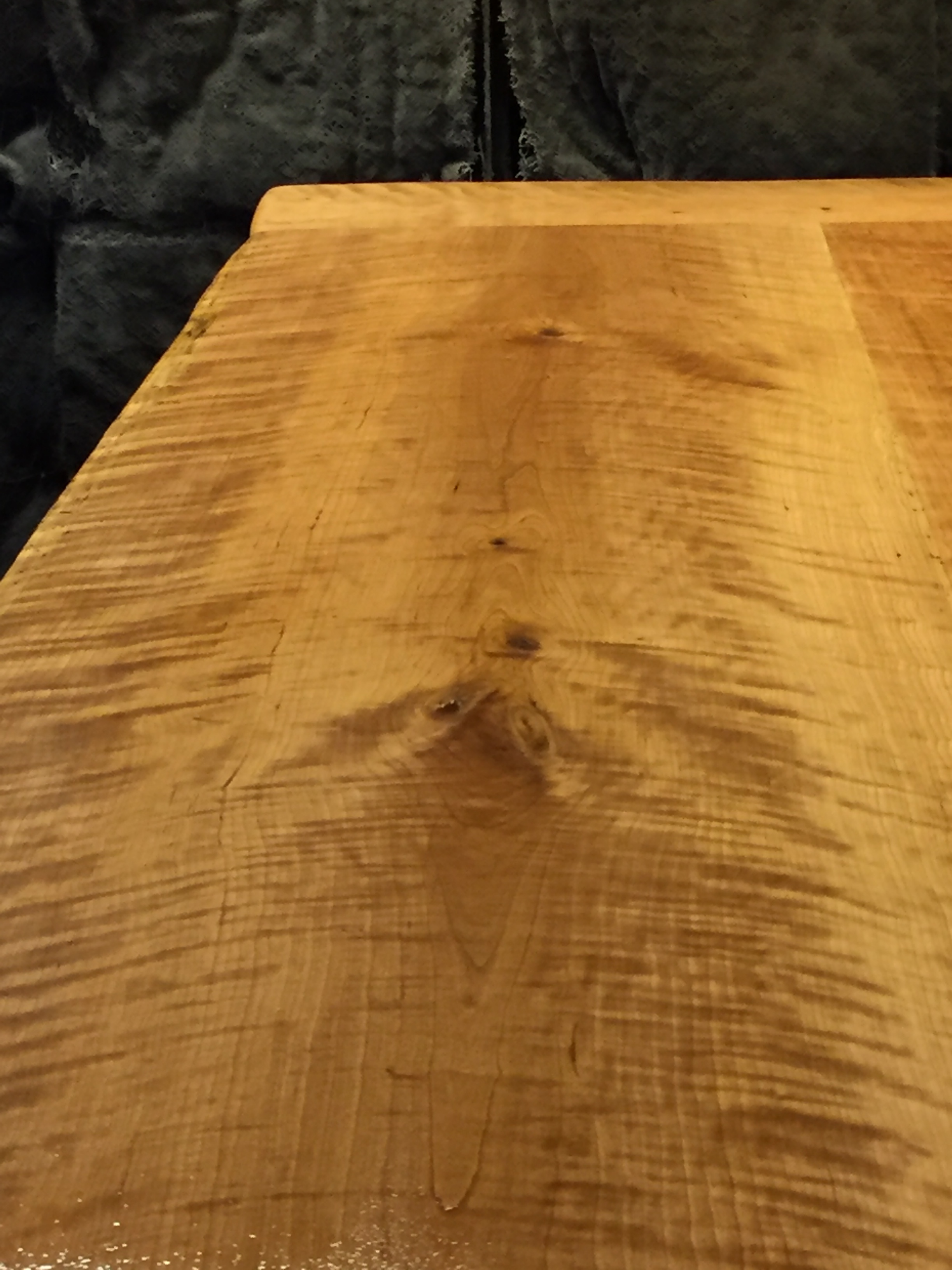 8/4 Curly black cherry slabs table close up