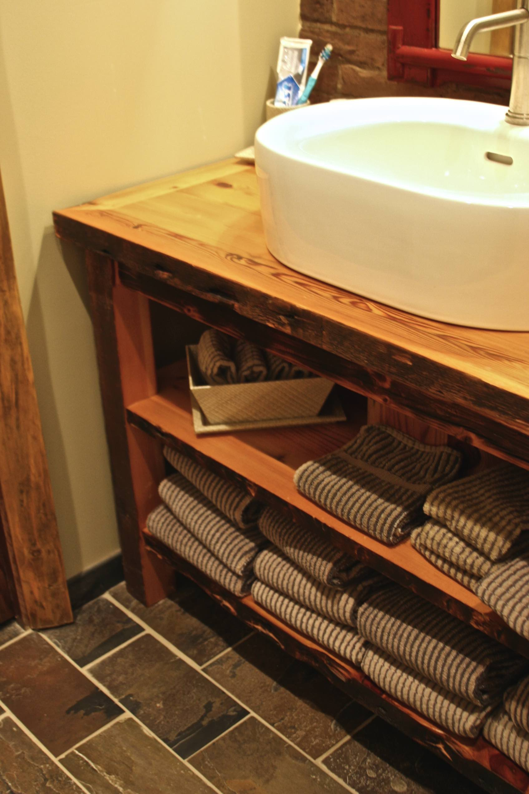 Salvaged barn wood vanity with 2 shelves.