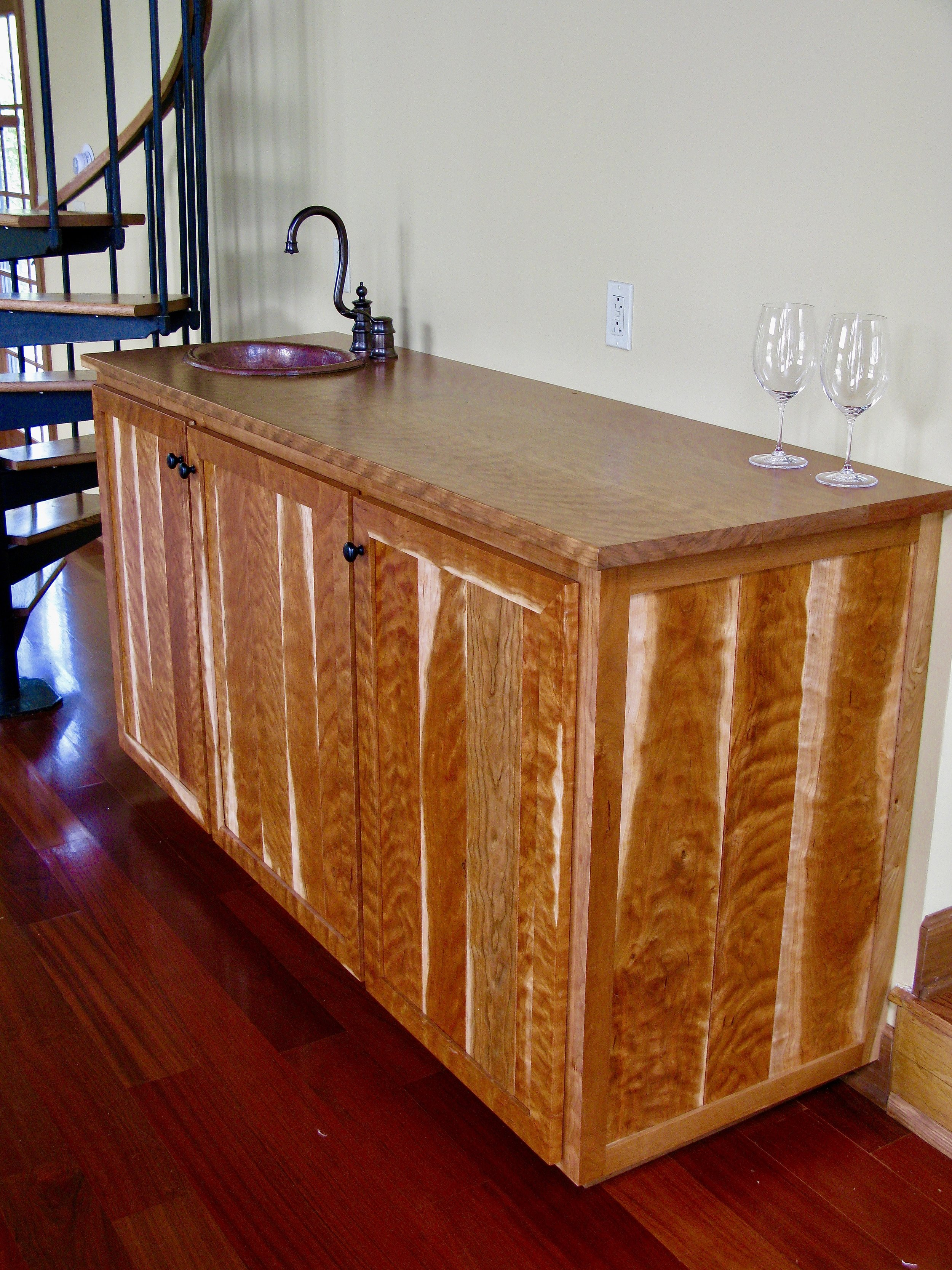Curly cherry wet bar with copper sink