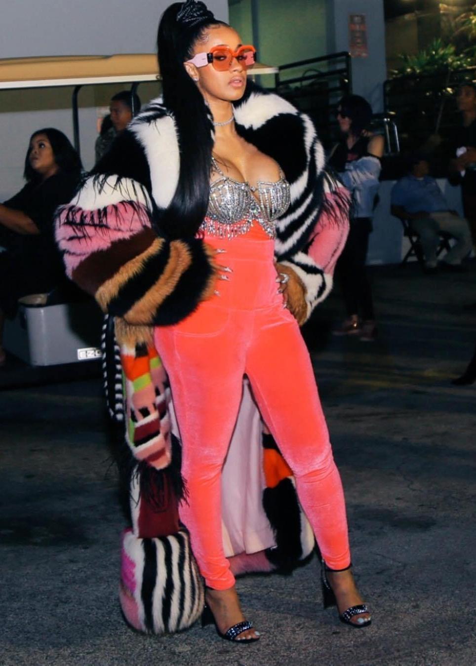 Cardi B performed at the BET Hip Hop Awards wearing a fabulous fur coat, hot pink velour pants and a diamond bra.