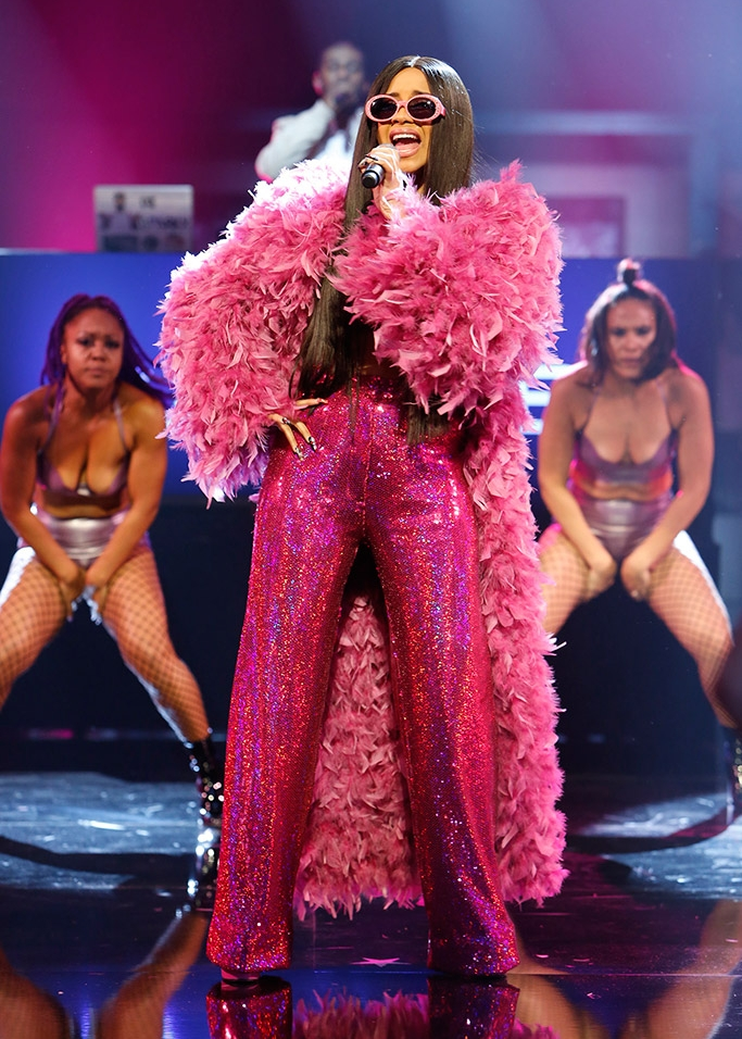 Cardi B gave us life wearing a pink feathered coat, a two-piece sequined set, and vintage Chanel frames during a live performance on the Jimmy Kimmel show.