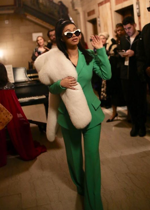 Cardi B making shmoney moves in an all-green pant suit.