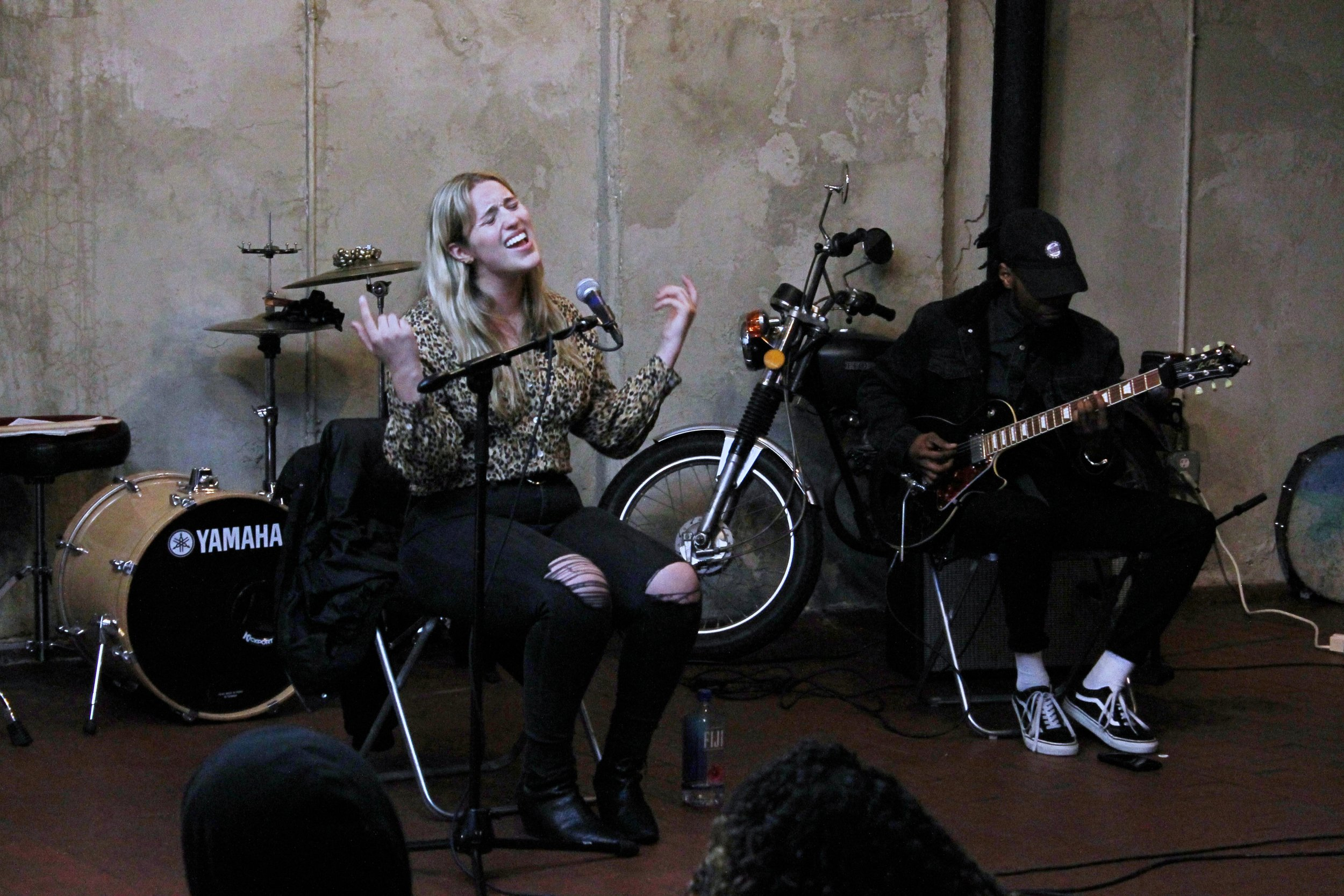 Sydney performing alongside her guitar player at a SoFar Sounds show in Bushwick