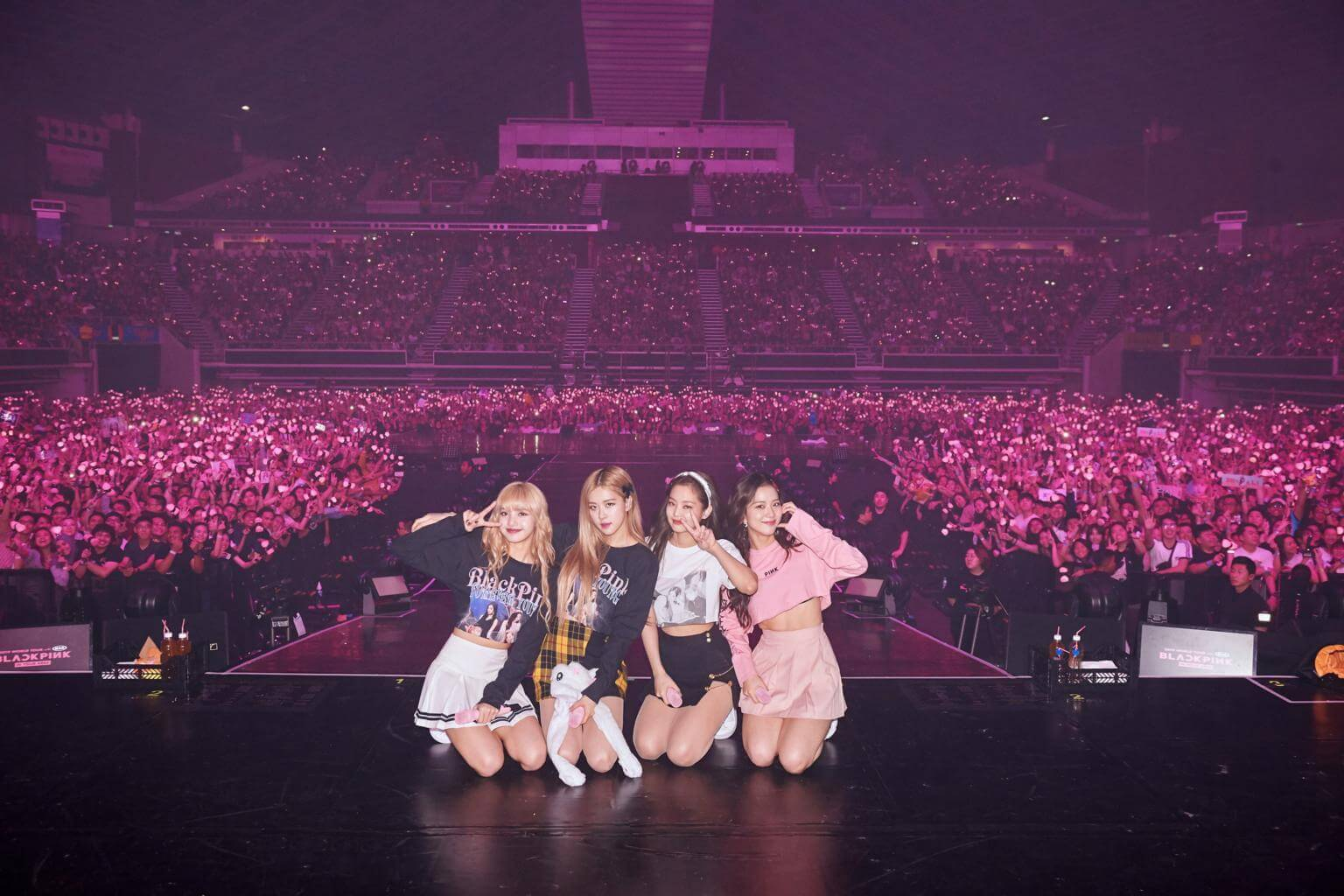 BLACKPINK members pose with fans