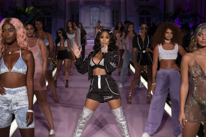 Source:  InStyle   Saweetie performing at the PrettyLittleThing x Saweetie show at NYFW
