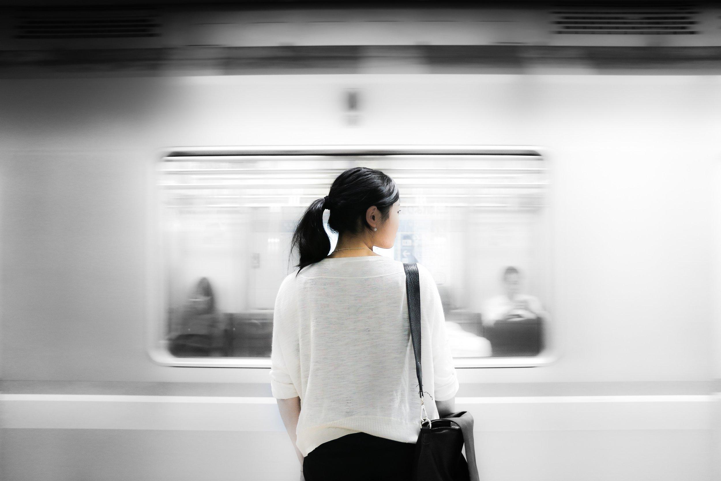 woman looking at moving train Shinjuku Tokyo Japan.jpg