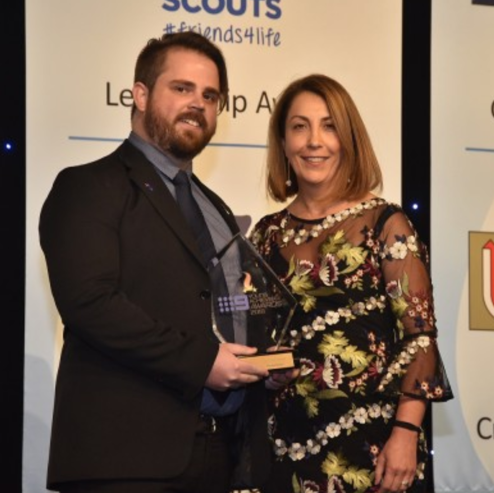 Thomas Brown (L) was presented with the  University Senior College Create Change Award by Anita Zocchi (R), Principal of University Senior College.