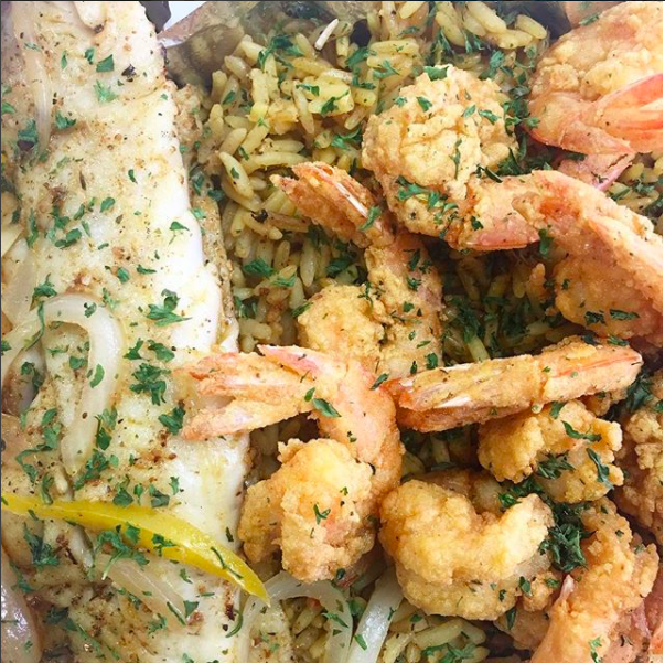 Conch CitySeafood  - Fish and Shrimp Platter DUO served over seasoned yellow rice.