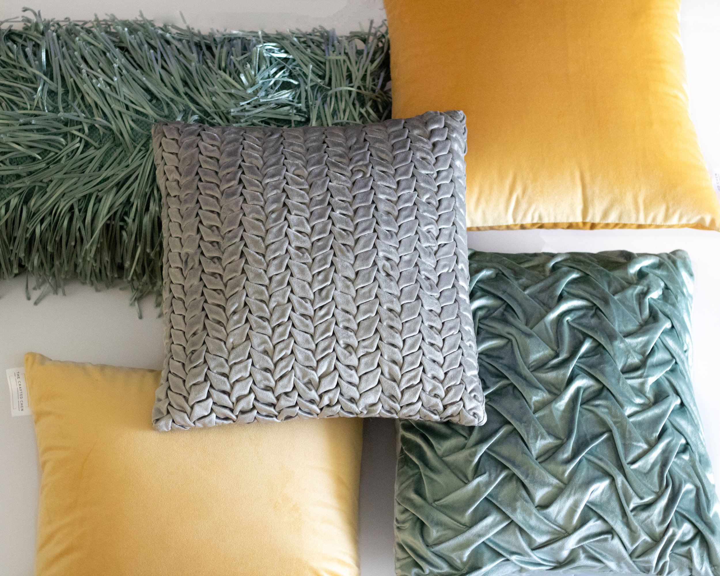 CRAFTED SHOP - Decorative Pillows, Textured Accents, Confetti Glassware and more all available now.