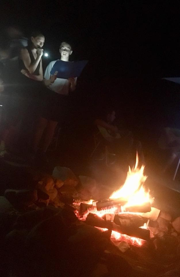 classical students praise and worship by campfire.jpg
