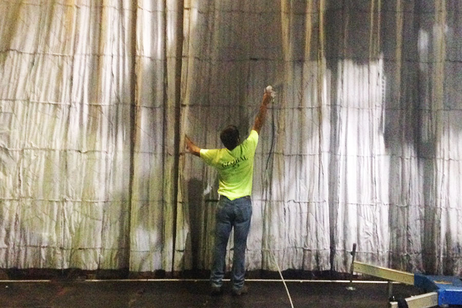 House of Blues Orlando Stage Curtain being Field-Treated with Fire Retardant.jpg