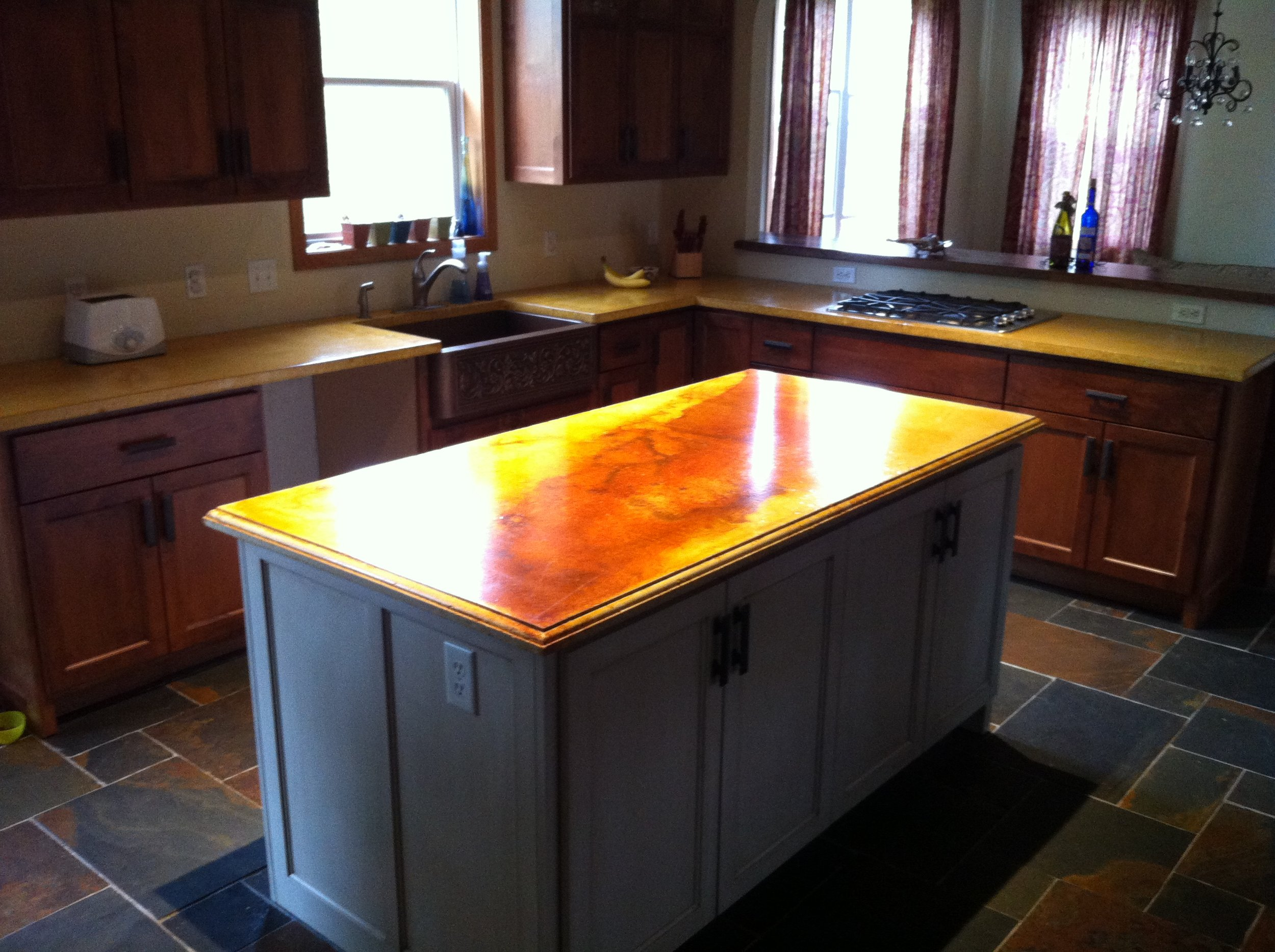 Concrete kitchen countertops and island (stained)