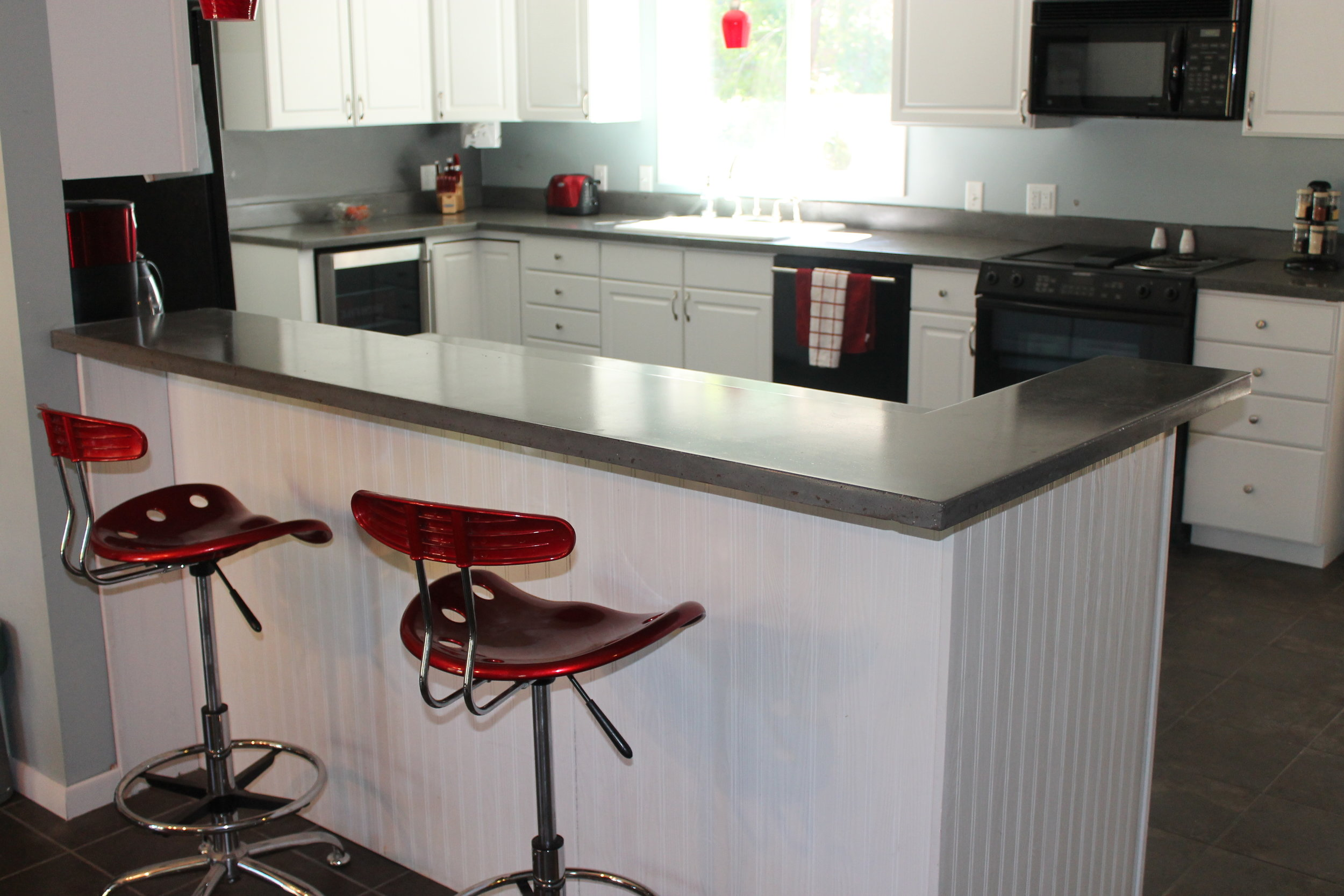 Polished concrete kitchen countertops and island
