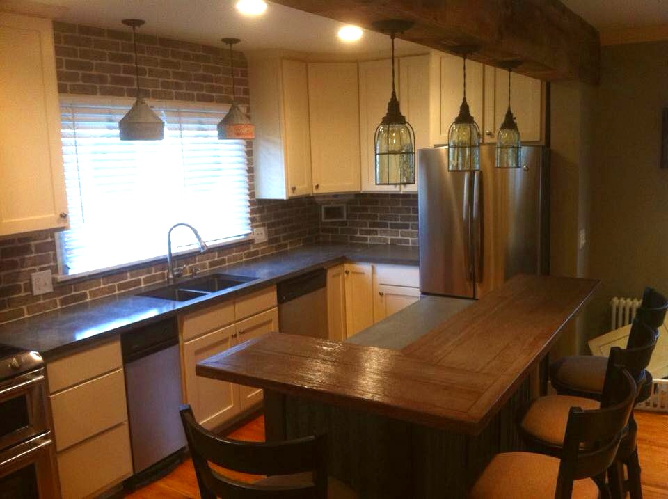Handmade kitchen cabinets with polished concrete countertops with concrete wood grain island