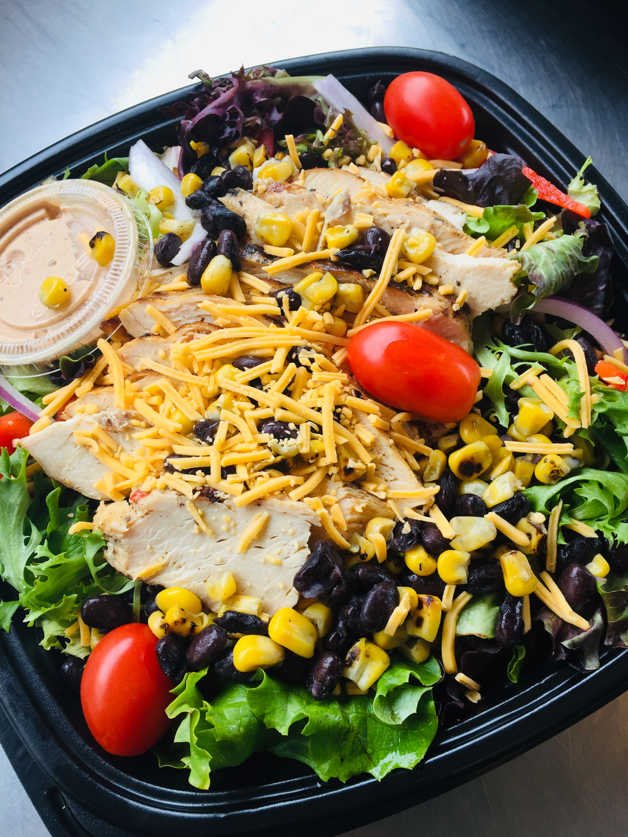 Southwest Salad:  (Lettuce, Cheddar Cheese, Grilled Chicken, Black Beans, Roasted Corn, Peppers with Southwest Dressing)