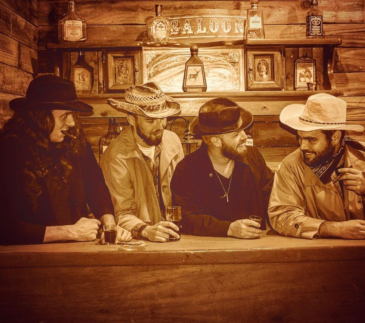 "SPONSORED BY VALOR OUTDOORS, www.valoroutdoors.com   CARY MILLER,ANDY CANNING,CODY COX,JOEY TAYLOR  Cary,Andy and Cody are the 3 original band members. The band formed because Andy and Cary met in a hotel in Iowa where they worked at the same company clearing right of way for Americas Oil Pipelines not knowing each other before hand Cary and Andy already had ONE thing in common. MUSIC. Cary had brought his guitar along with him and showed Andy some of his ORIGINAL music Andy grew very fond of his music because it was country/pop/southern rock. He then told Cary of how he used to be a drummer and had to sell his drum kit when he joined the U.S. Navy, they both reminisced about how they used to be in bands in high school, Andy then told Cary of a Band he used to idolize back then little did Cary know it was one of the bands he'd been in playing bass at the time. Cary was kind of reluctant when Andy suggested the idea of forming a band, Cary said well if you can find the players then ill start a band with you, Cary thought good luck because he'd been searching himself and had no luck. Shorty one week later, Andy had done the impossible and had found all the members of the Cary Miller band Cody Cox on bass which Andy and Cody had been prior comrades growing up and a lead guitarist who eventually didn't work out although the band still went on to play shows consisting of the TRIO they still made some really good headway and gained attention, they remained the TRIO until Cary invited ""Lare Bear"" Larry Jarman to come and see if it would be something he would be interested in although Larry never says he's a full time member he's ended up being a full time/part time member as needed to fill the vacant spot and has been a great asset to the Cary Miller band. The band finally found their 4th full time member Joey Taylor with his tasteful guitar licks and smooth jazzy style, after 4 years of searching and he's become part of the CMB family in a short time fulfilling the sound they were looking for. The band has been going strong chugging along ever since. Opening for National and Nashville recording artist alike (which the Cary Miller band is also) in less than 4 years they've grown considerably as one and don't plan on stopping until they reach the goal they have set in mind… As they have partnered up with their sponsor ValorOutdoors and signed with SMG records of Nashville,TN and currently released their fan favorite and hit song ""100 Proof"" to major country radio and it being successful since Day 1 of their radio premier and is still sweeping the nation."