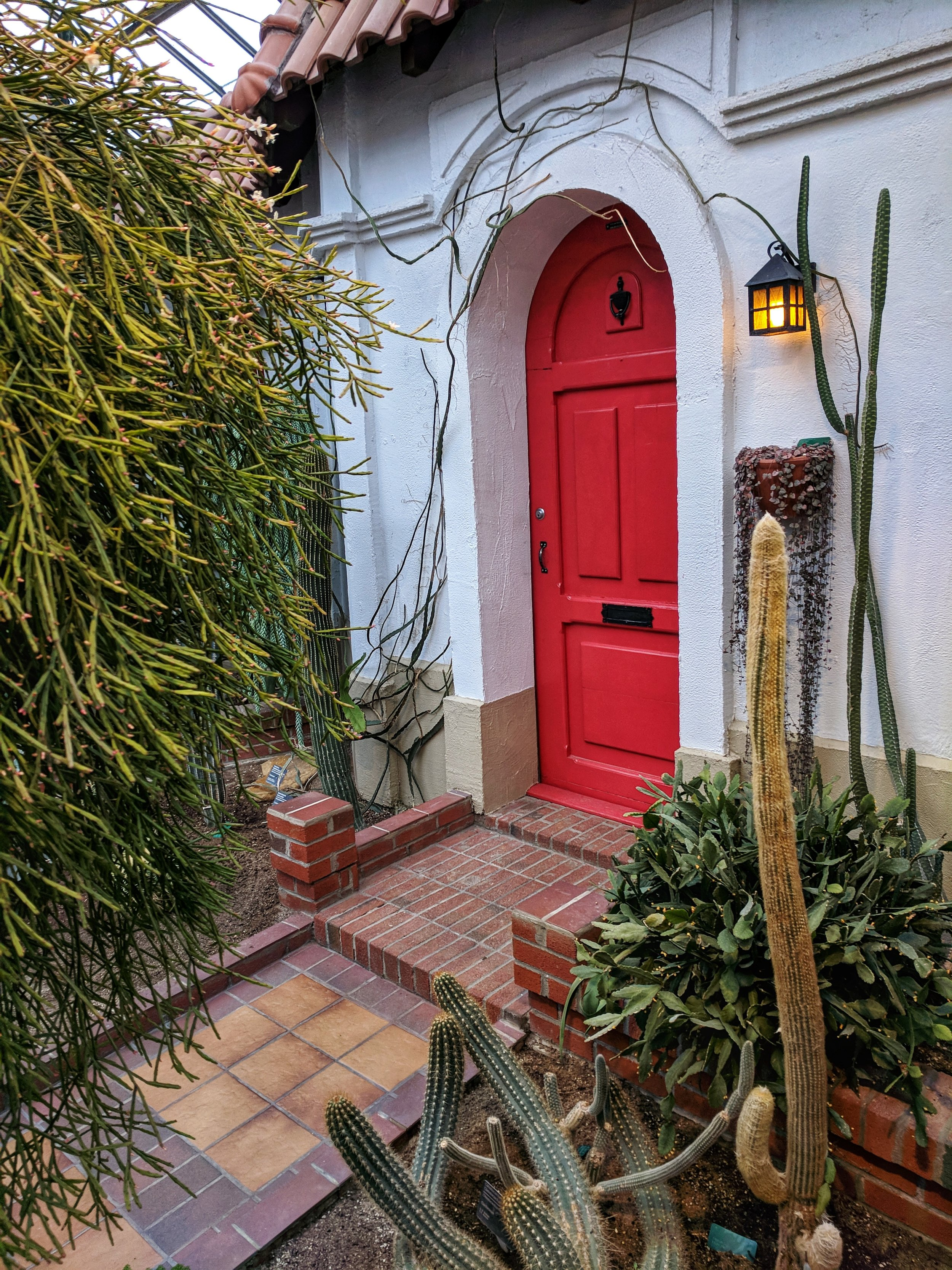 The red doorway in the Hacienda Room at the Botanical Garden