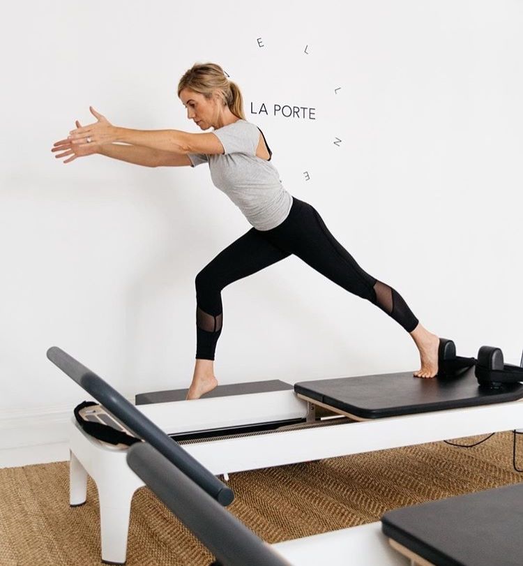 Image of Kirsten King using the contemporary Balanced Body reformer at Laportex Sydney