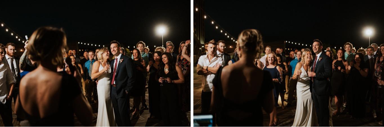 78_The Penthouse - Pat Cori Photography - Virginia Wedding Photographer-157_The Penthouse - Pat Cori Photography - Virginia Wedding Photographer-156_reception_rooftop_toasts_roanoke_thepenthouse_Wedding.jpg