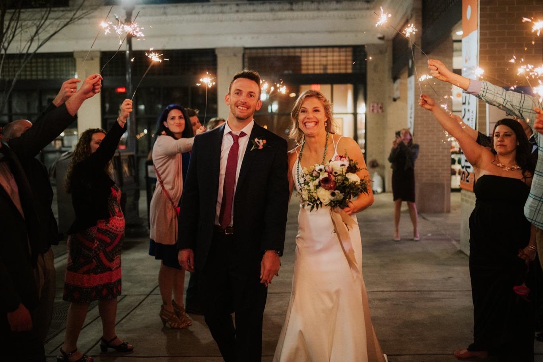 90_The Penthouse - Pat Cori Photography - Virginia Wedding Photographer-180_Sparklerexit_rooftop_roanoke_downtown_thepenthouse_Wedding.jpg
