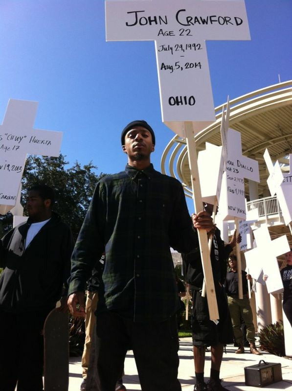 MarShawn McCarrel leading a rally after the death of John Crawford.