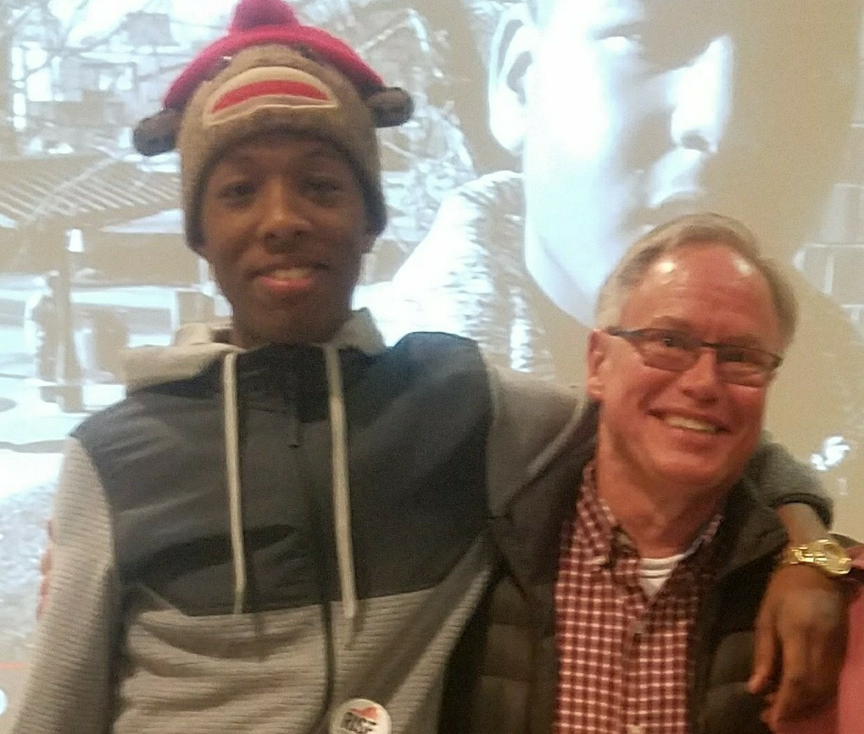 """This one is me with one of my ex-Richmond Juvenile Detention Center kids, Doug, taken at the Richmond Mayor's YouthVoiceMattersRVA Town Hall Meeting on Youth Violence held on Jan. 18, 2018 at the downtown Richmond Public Library. After his release from Detention, Doug has been consistent in working with Rise for Youth, a youth justice reform initiative of the Richmond Legal Aid Society. It's always good to see one of """"my kids"""" doing well, and especially using their knowledge of the juvenile justice system to lobby and work for juvenile justice reform, as it can lead to major improvements for Black family cohesiveness and for the benefit of the entire black (and white) communities. One of my interests is in lobbying for economic equity and racial justice for the Black community in Richmond and the U.S."""