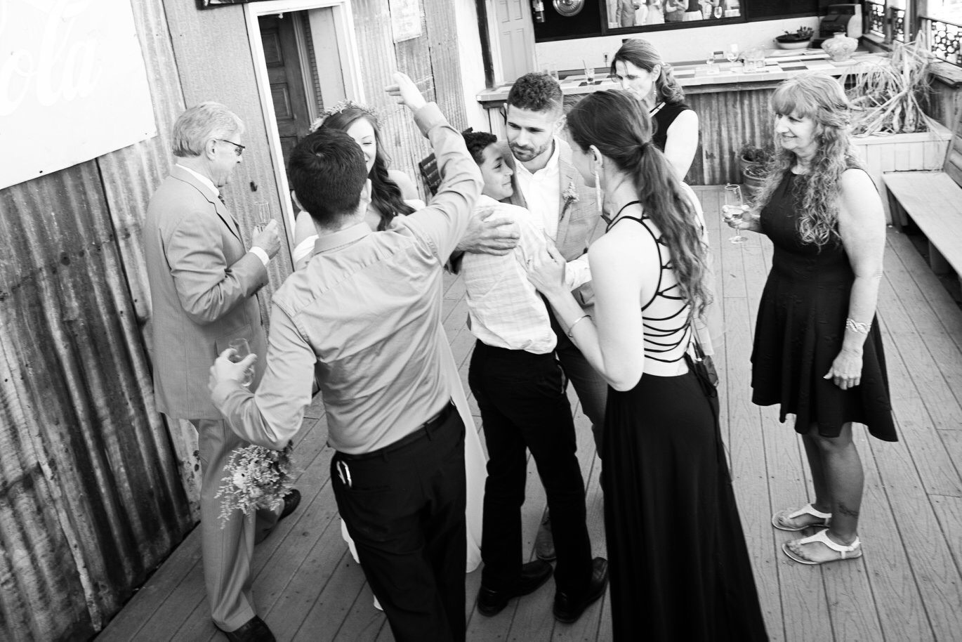 """The next 3 photos   were taken 3/31/2018 during my brother's wedding at Havana 59 in the historic   """"17th st. market"""" area of Richmond. My brother and sister in law asked me to   officiate their wedding ceremony. This photo was taken moments after it was   over. My brother is seen embracing my oldest child who was overcome with   happiness for him. I love seeing their tender embrace. Also in the photo is   myself, my husband seen embracing my SIL. My father to the left, my mother is   in the back right, and my brother's MIL is in the right."""