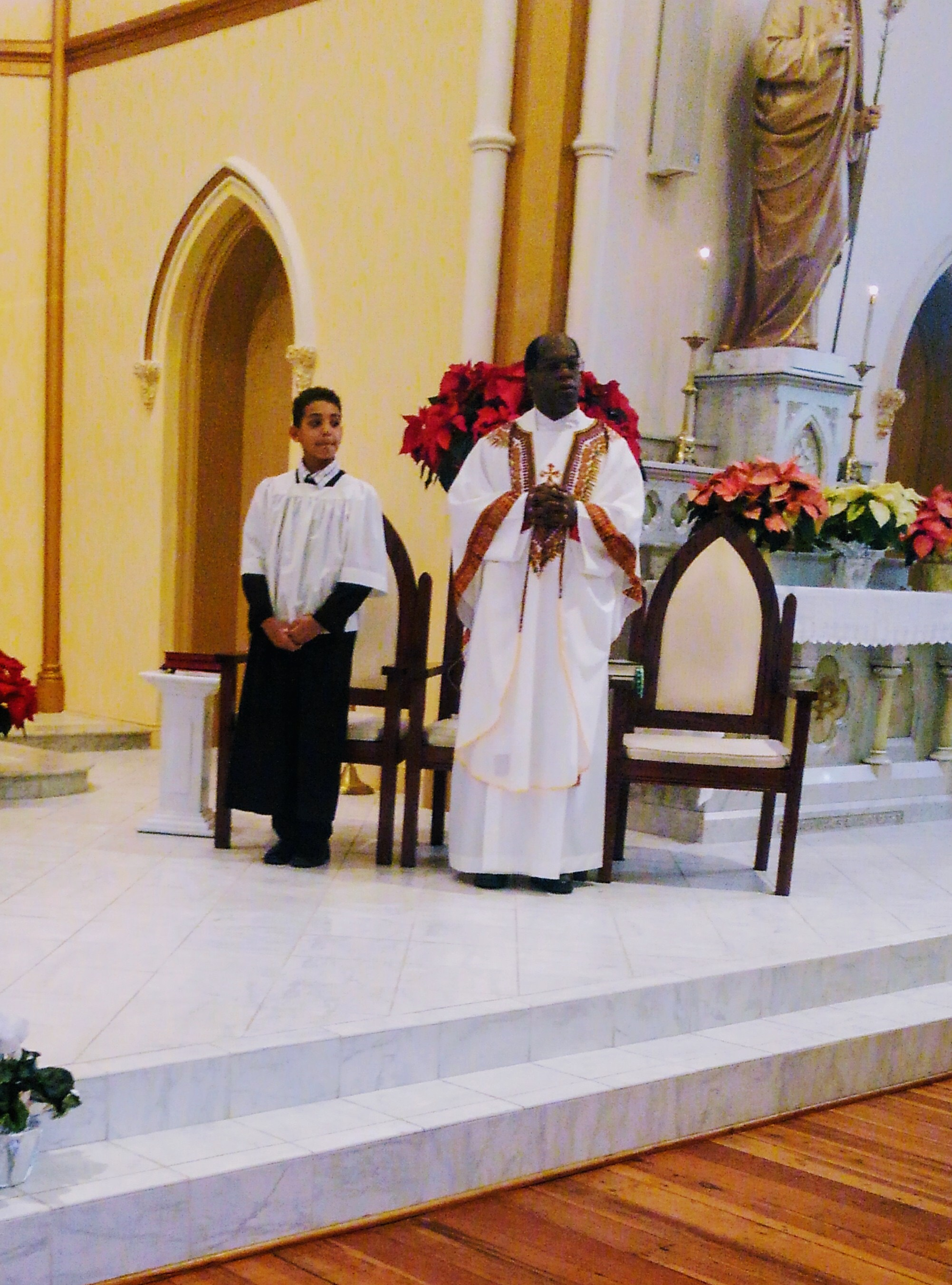 This is a photo taken   12/25/2017 at St. Patrick's Catholic Church. That is our oldest son Murphey   altar serving on Christmas day. This photo encompasses a couple things that   are important to me, family, faith, and the community of our church.
