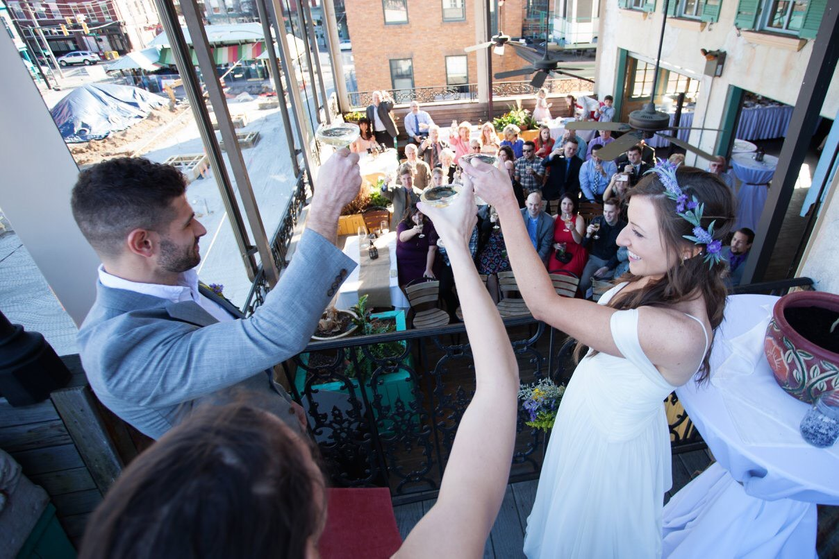 We decided to end  their ceremony with a toast. I love this photo of a community coming together   to celebrate new beginnings.