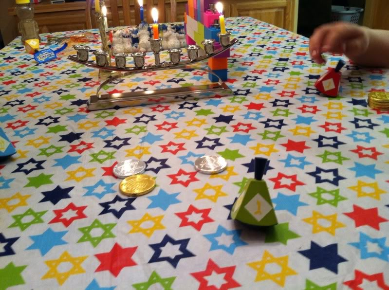 Playing dreidel during Chanukah. I no longer attend synagogue regularly, but I am still proudly Jewish.
