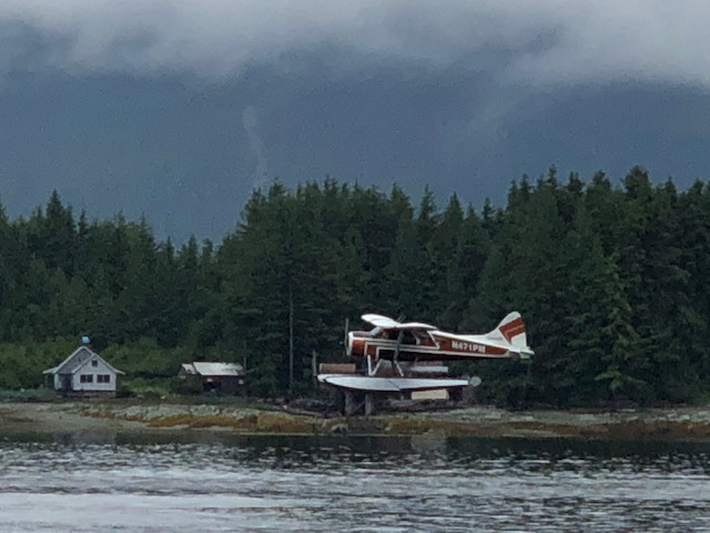 Float plane taking off in front of Pennock Island - directly across the Narrows from   Ketchikan.