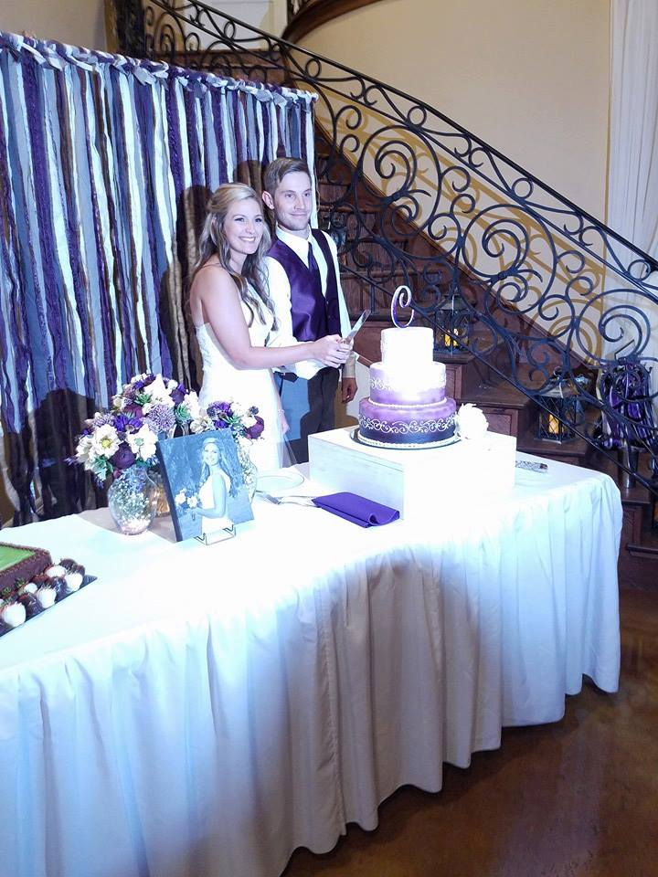 purple backdrop with bride and groom.jpg