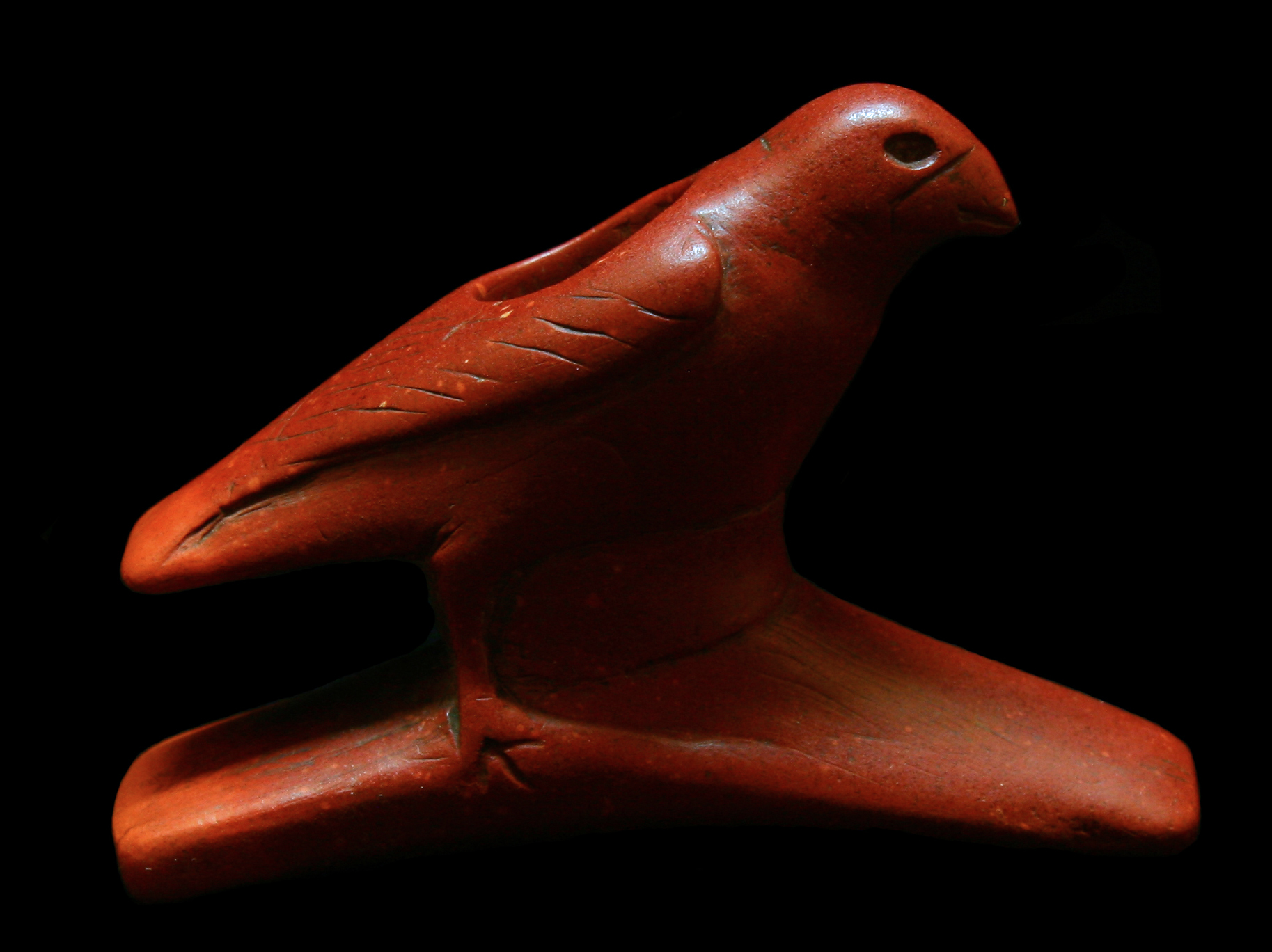 """The """"McAdam's"""" bird effigy, (ca. 200 BC - 200 AD) found in southern Illinois, is carved from red Illinois pipestone."""
