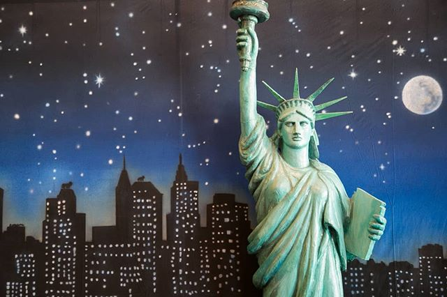 """""""Keep, ancient lands, your storied pomp!"""" cries she With silent lips. """"Give me your tired, your poor, Your huddled masses yearning to breathe free, The wretched refuse of your teeming shore. Send these, the homeless, tempest-tossed to me, I lift my lamp beside the golden door!"""""""