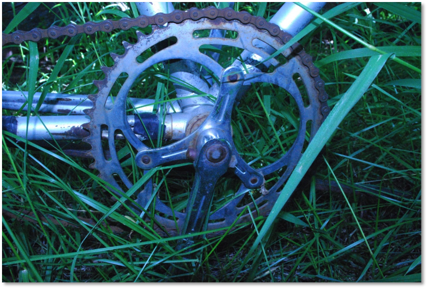 This photo shows the cotter pin attachment for the crank arms. This type of bike manufacturing has long been discontinued with the exception of very few modern bicycles.