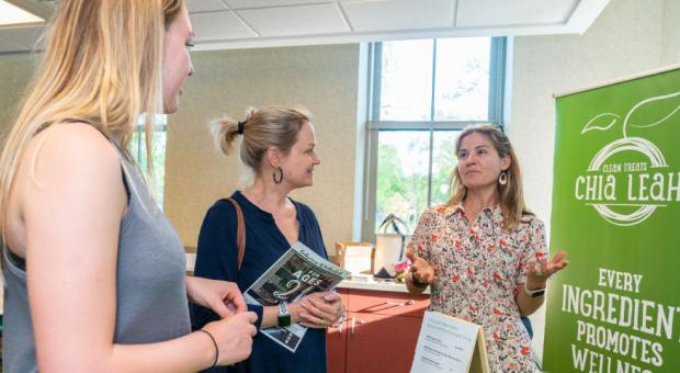 Wilmette's Leah Bostrom (right), of Chia Leah talks with Maggie and Liz O'Toole, of Wilmette, about her healthy snack foods.