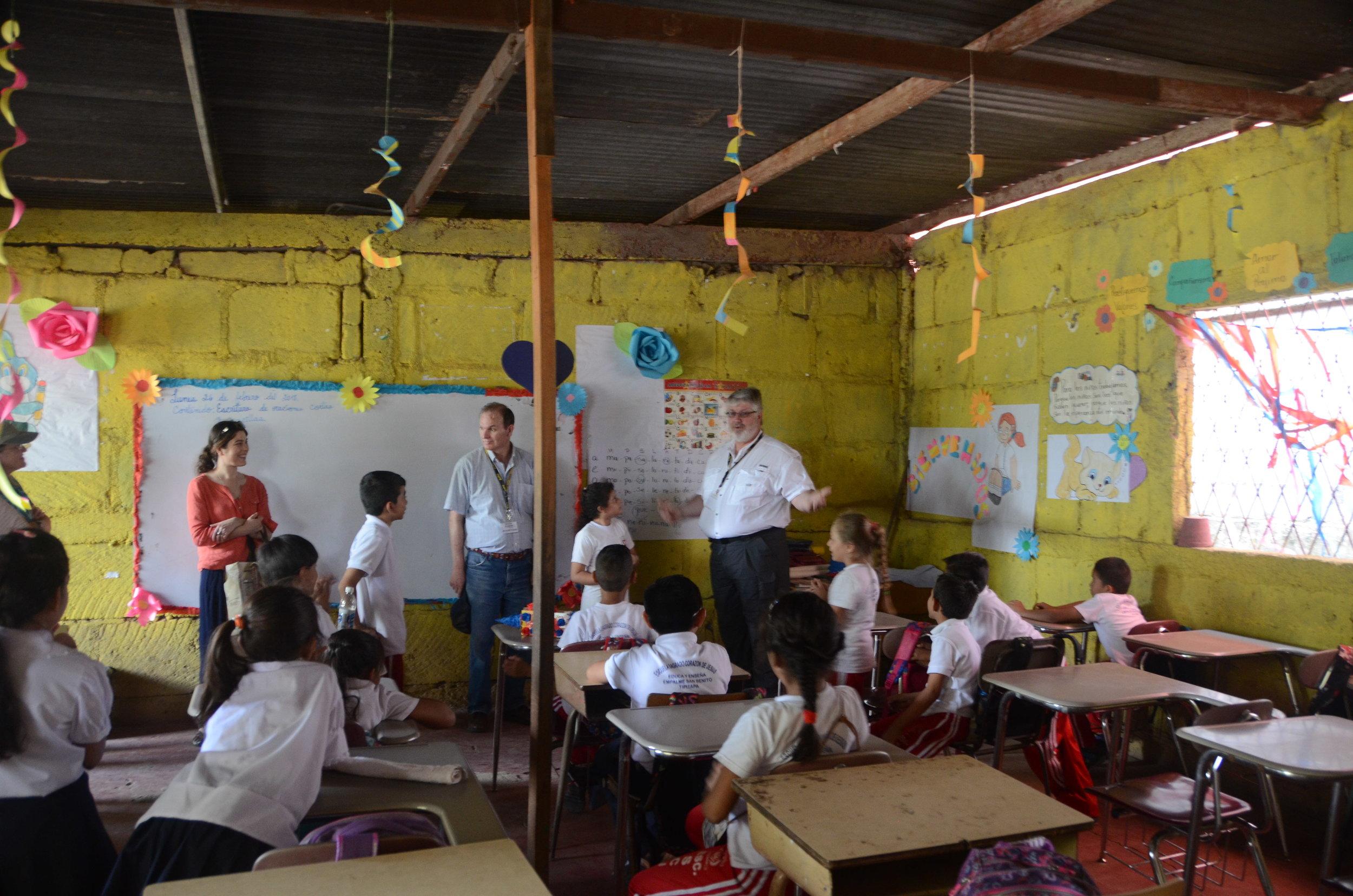 Mayor Mike teaching the kids the English Alphabet.