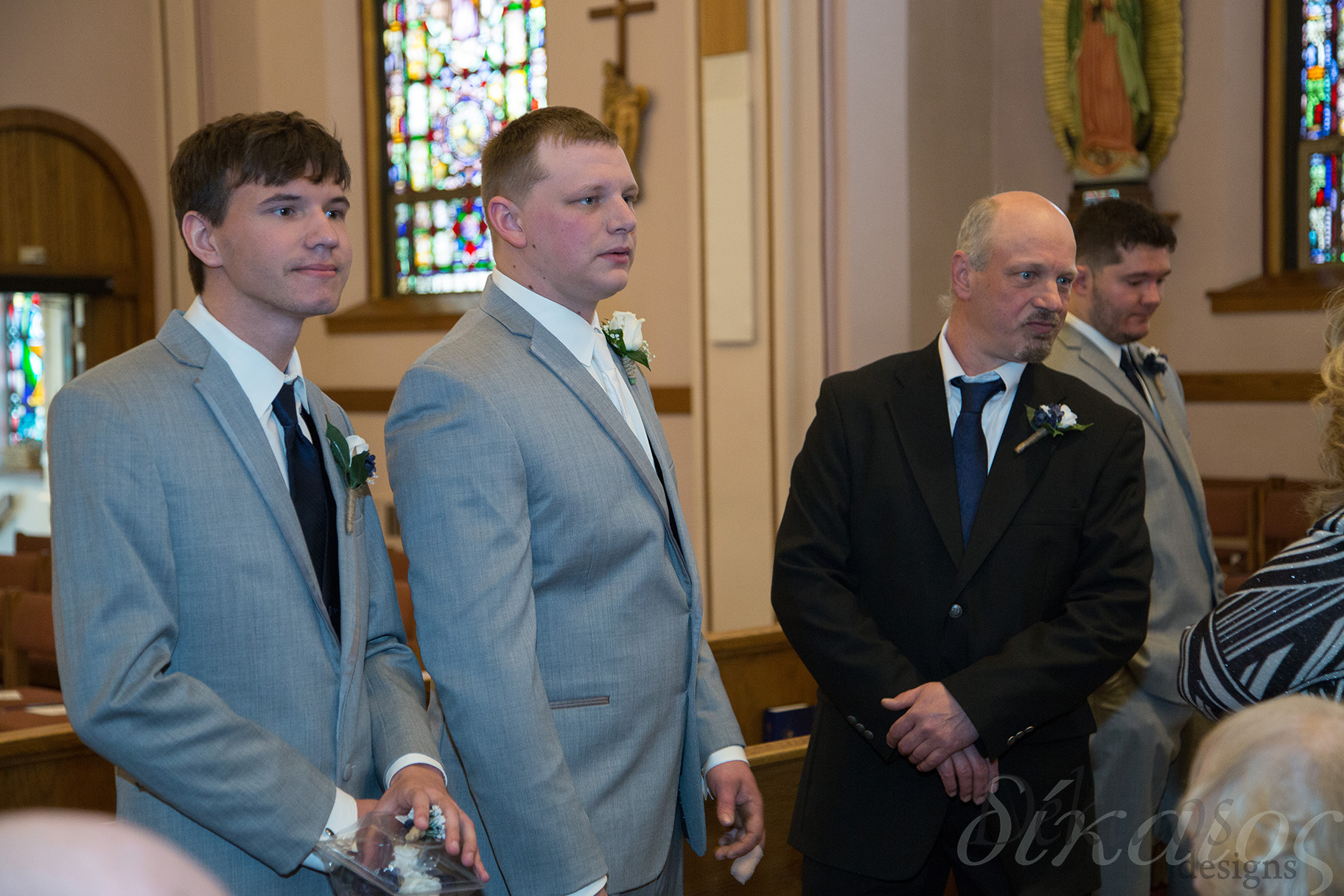 Jake in the middle, his brother, and father.