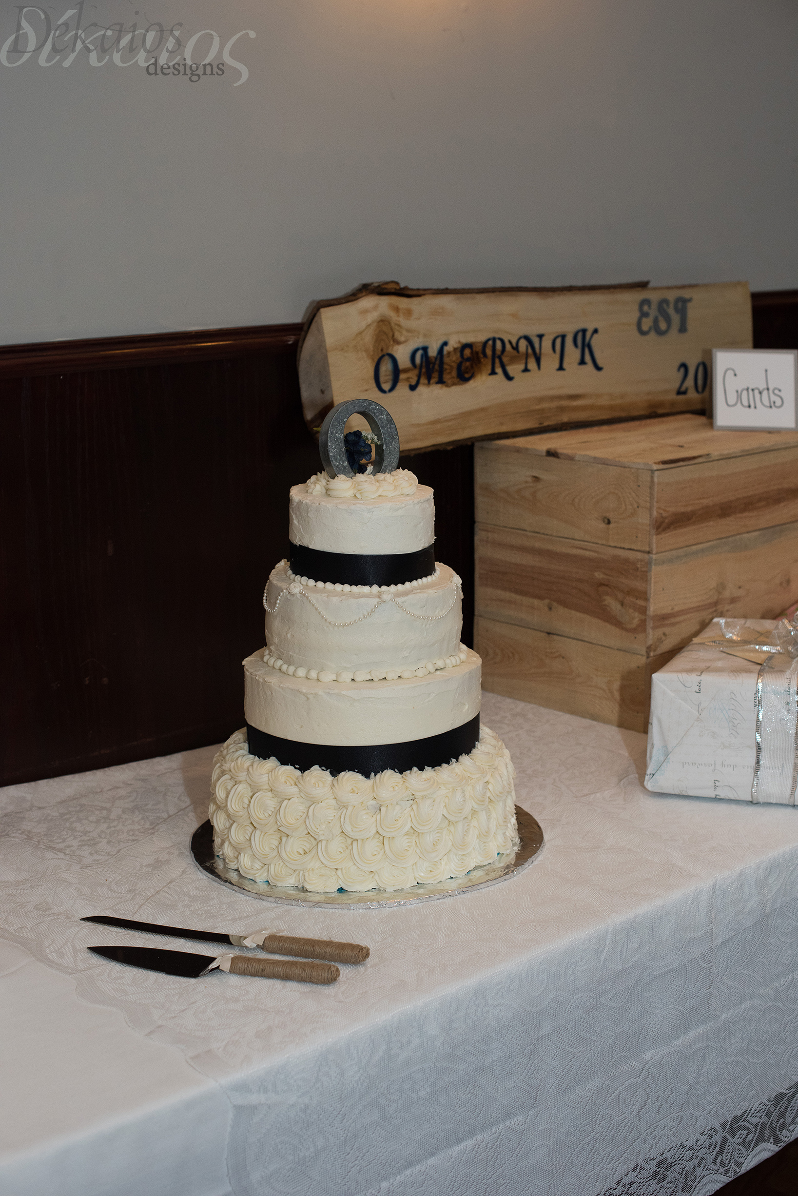 The log was made by Jake. I also thought the cake topper was a cute and creative way to use those tin letters.