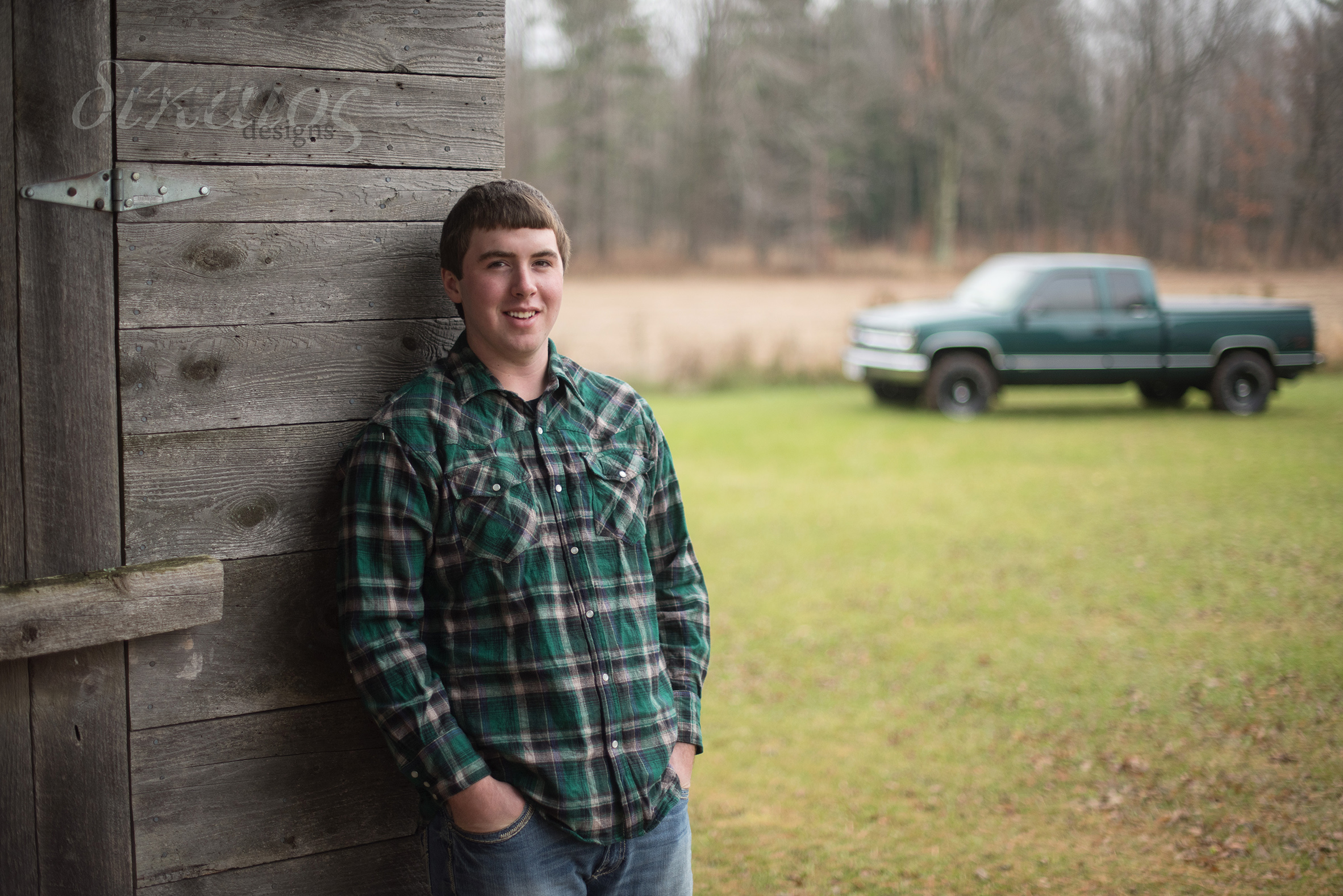 A guy and his truck on his family farm.