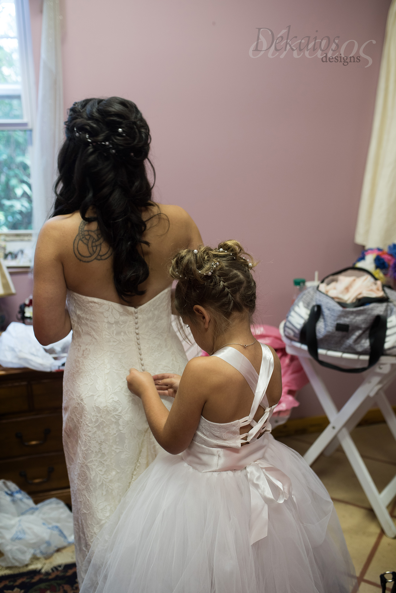 I entered to this sweet moment where Kristen's daughter was helping mom button her dress. So memorable and special, it's these moments that get me. I love what I do!