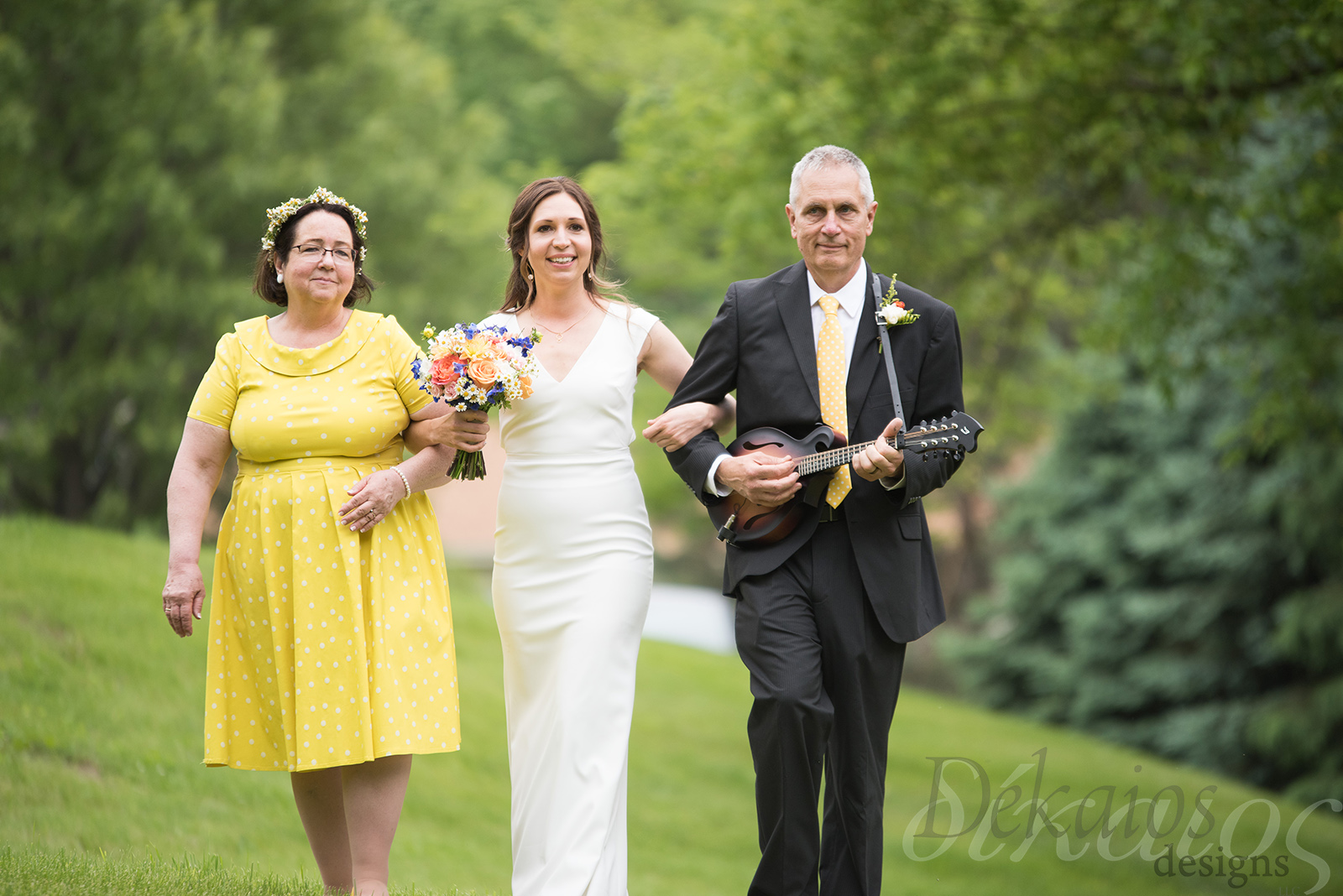 Dad played the mandolin as they walked up the isle.