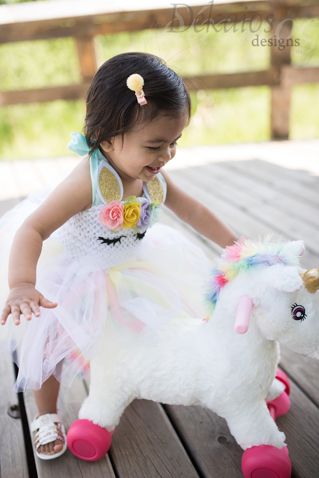 She had a unicorn themed birthday celebration. We had to get a few shots in her cute birthday clothing.