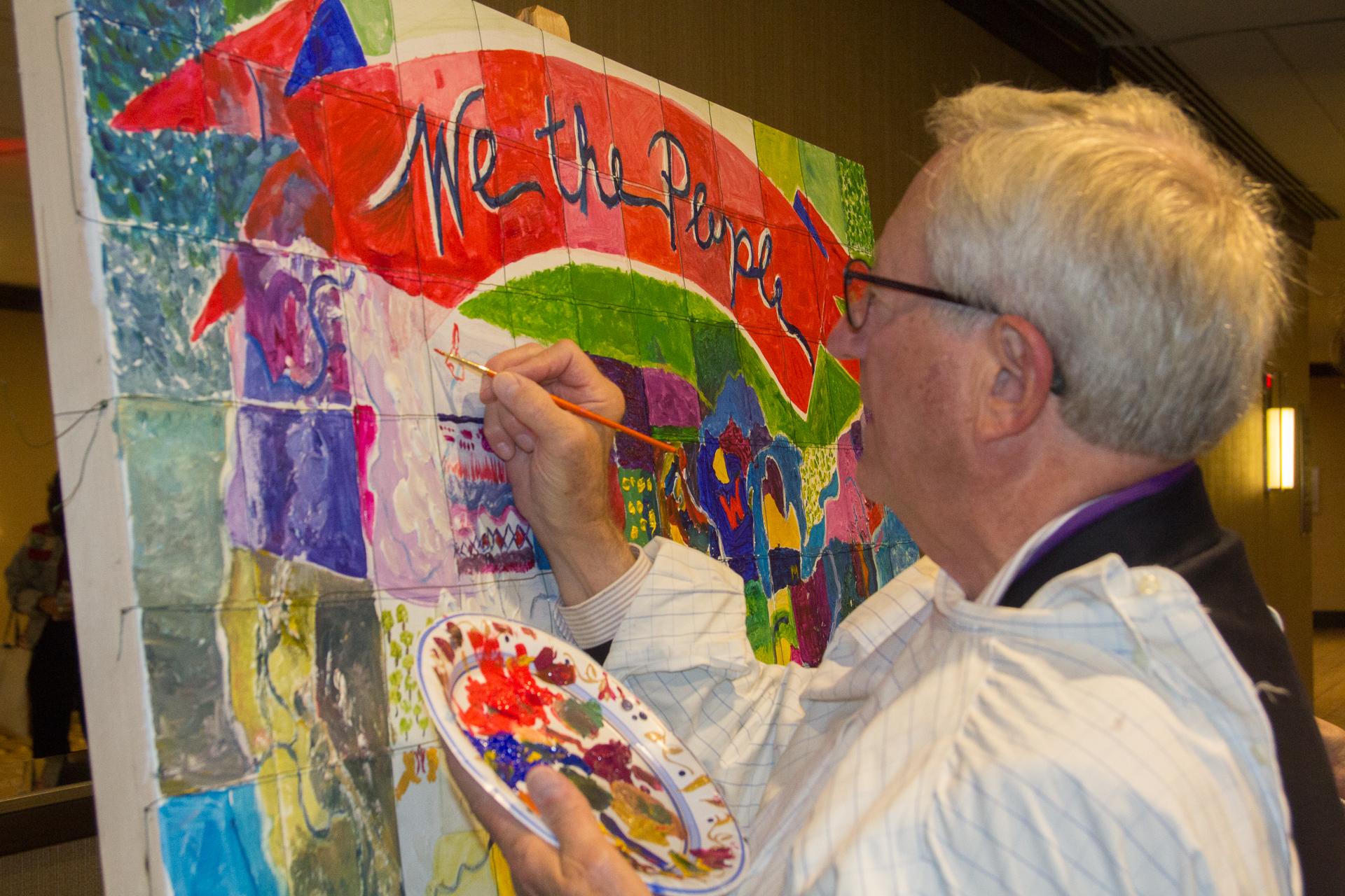 JC FAVE Jim Nelson paints copy.jpg